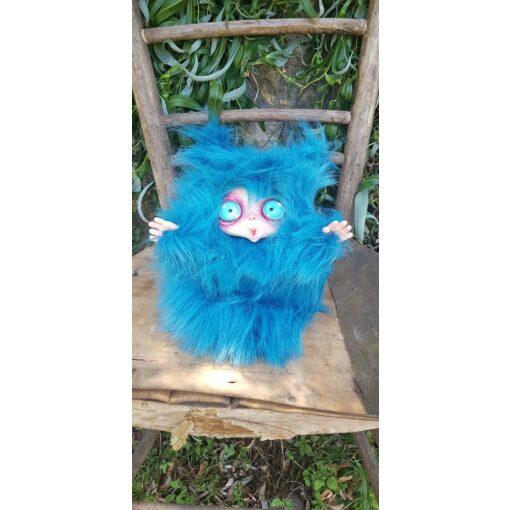 Peluche MicioMicio il Folletto che si traveste da gatto blu con occhi azzurri