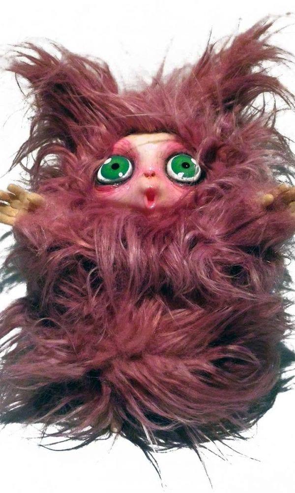 Peluche Peluche MicioMicio il Folletto che si traveste da gatto rosa con occhi verdi